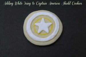 Adding White Icing to Captain America Shield Cookies