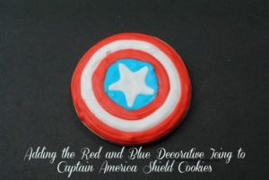 Adding the Red and Blue Decorative Icing to Captain America Shield Cookies